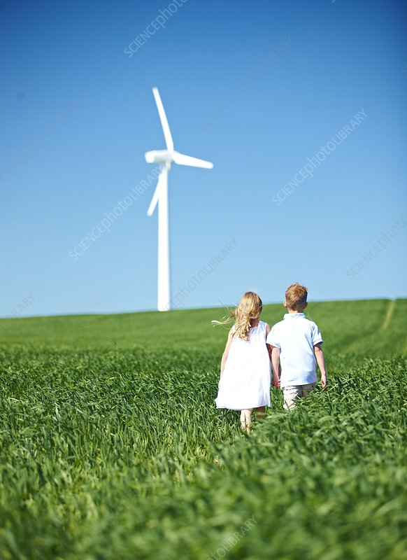 Boy and girl lookng at wind turbine