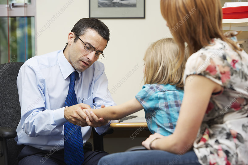 Doctor examining young girl