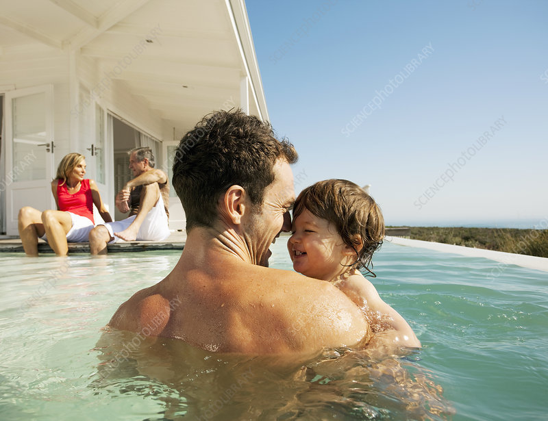 Dad with child in pool
