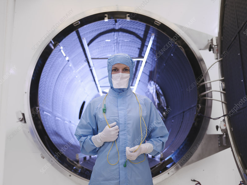 Worker with satellite testing chamber