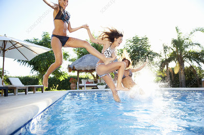 Girls Jumping Into Swimming Pool Stock Image F003 5324 Science Photo Library