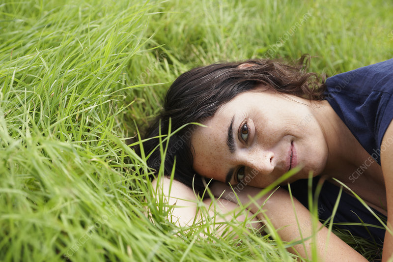 Woman resting in meadow