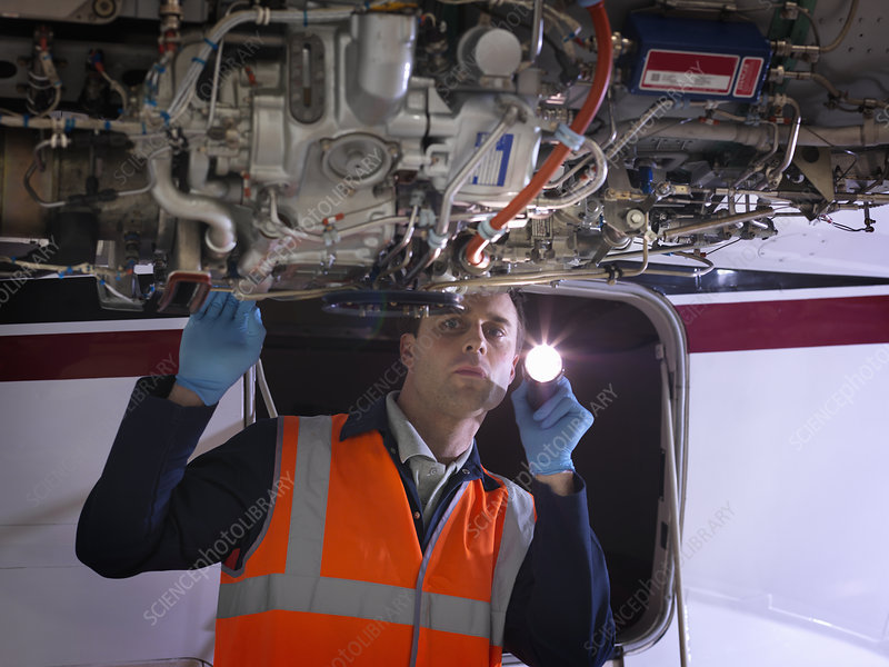 Engineer inspects jet engine