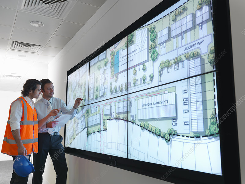 Town planners work at plans on screen