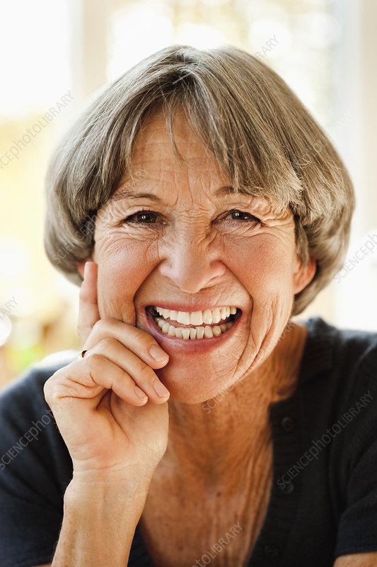 Old woman smiling at viewer