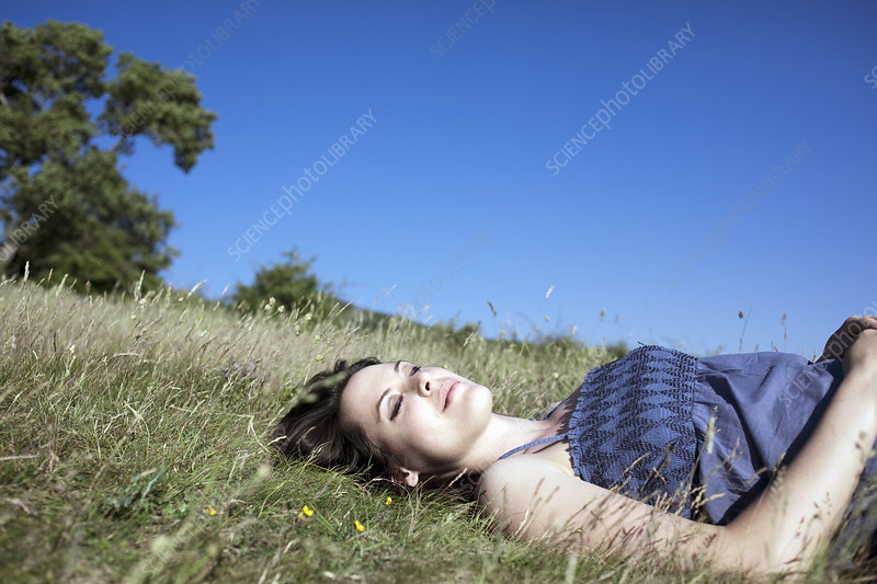 Woman relaxing on hill