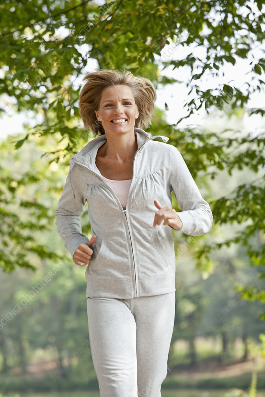 Middle aged woman jogging
