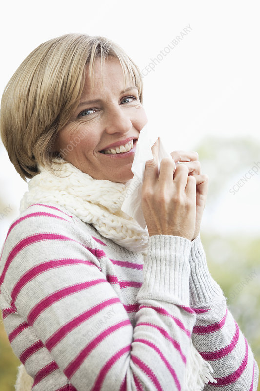 Middle aged woman with scarf and tissue