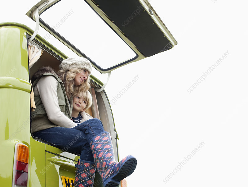 Mother and son at back of camper van
