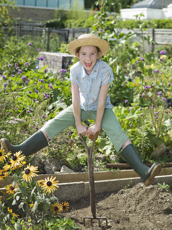 A young girl in a allotment garden