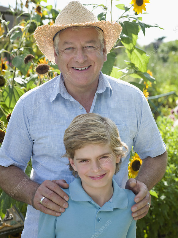 Father and son in a sunflower garden