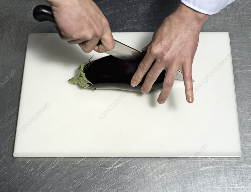 A chef cutting an Aubergine