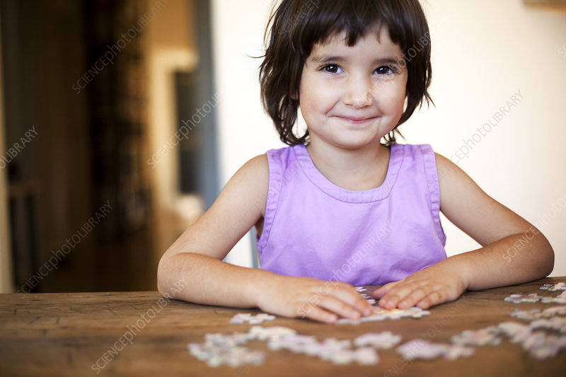 little girl puzzling