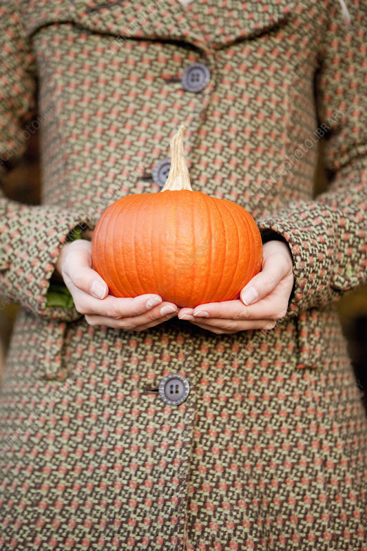 Woman with a pumpkin in her hands