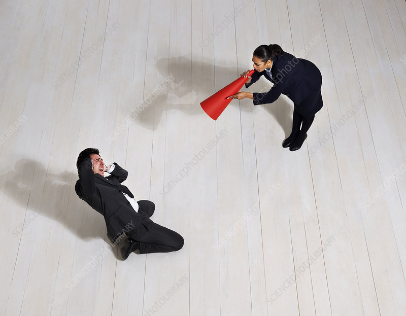 Business woman shouting at man on floor