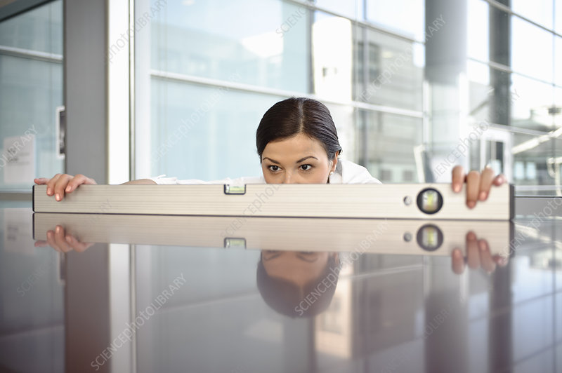 Business woman using spirit level