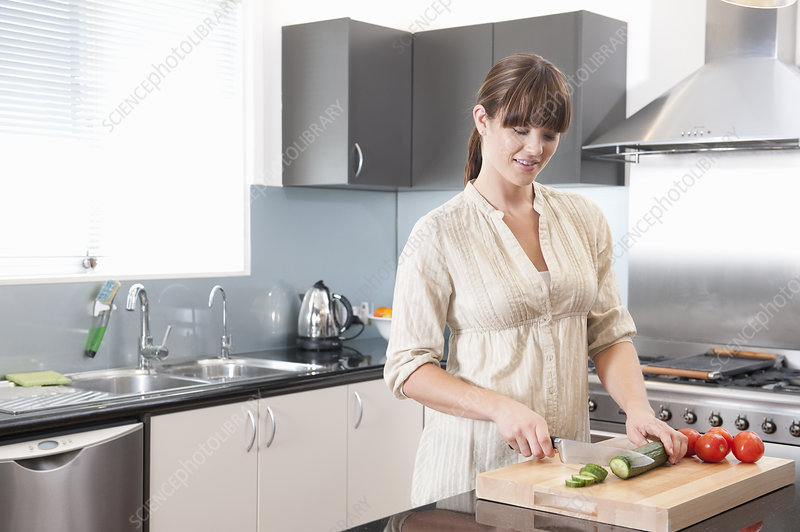 Young Woman at Home Cooking