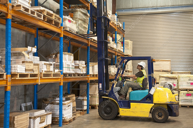 Warehouseman and Forklift Truck