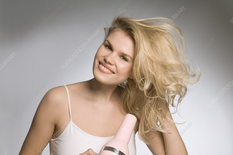 Female beauty drying hair