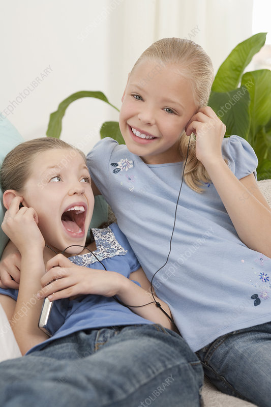 Two girls listening to an MP3 player