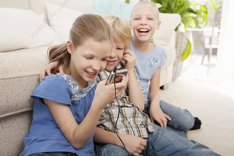 Children playing with an MP3 player