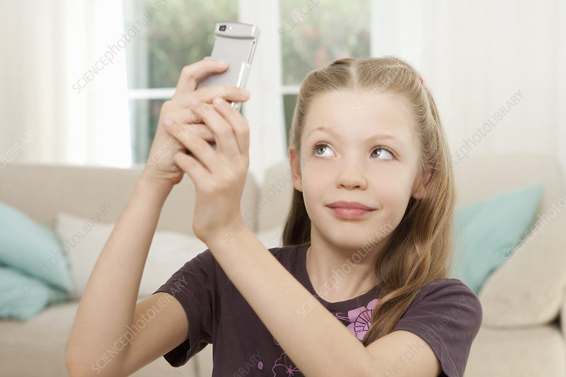 A girl taking pictures on her mobile