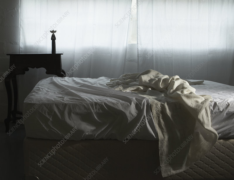 Unmade bed in morning light