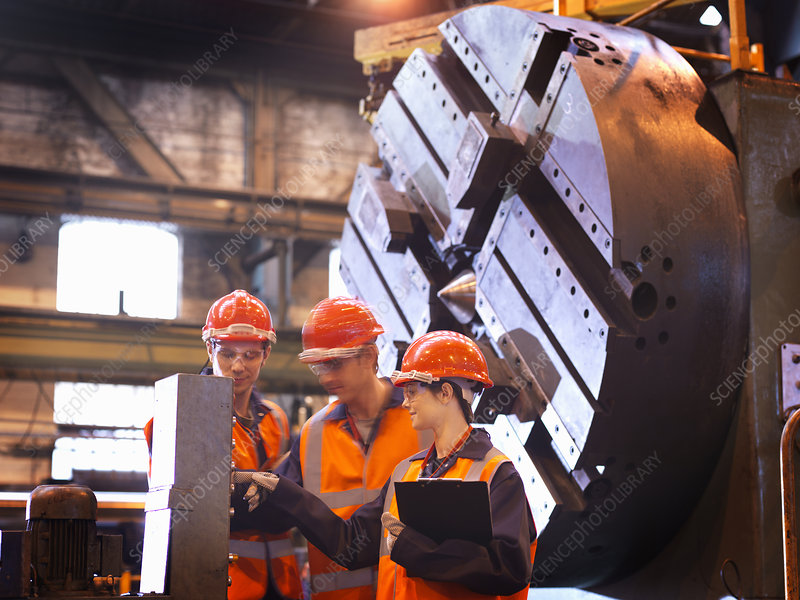Steel Engineers With Lathe