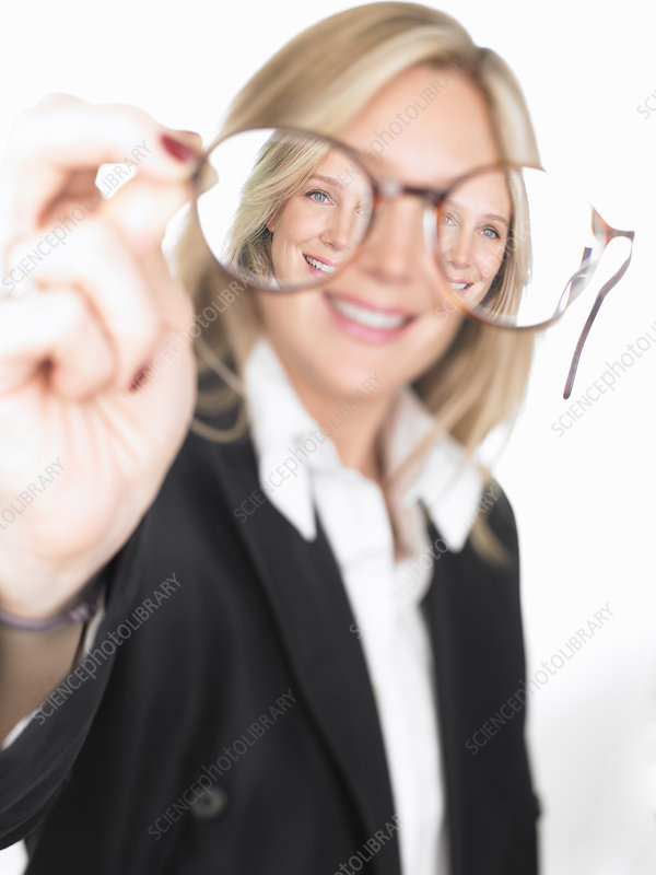 Woman holding glasses in front of her