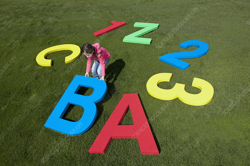 Young Girl Playing with Giant Alphabet