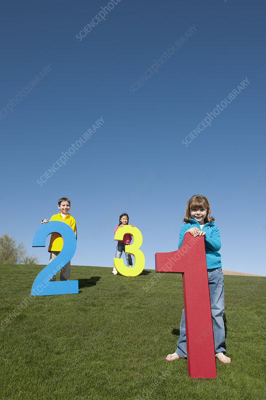 Group of Children with Giant Numbers