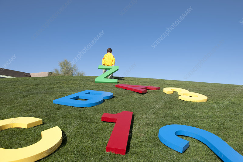 Boy Playing with Giant Letters & Numbers