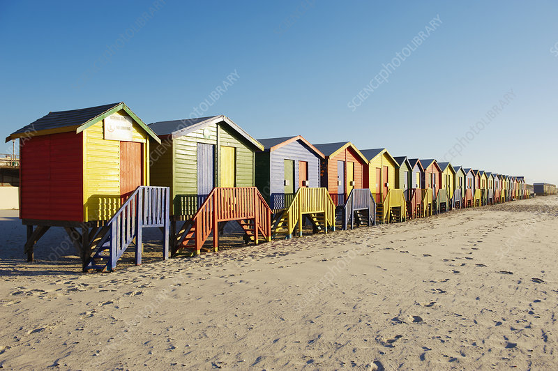 Row of colorful beach huts on beach