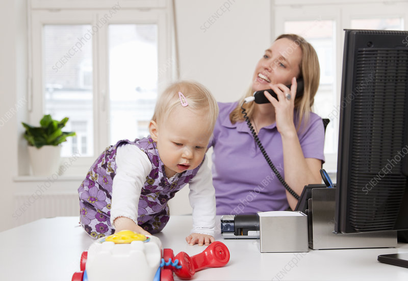 Businesswoman and baby in office