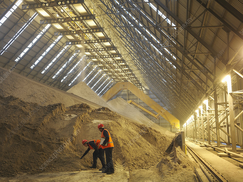 Workers Inspecting Gypsum Store