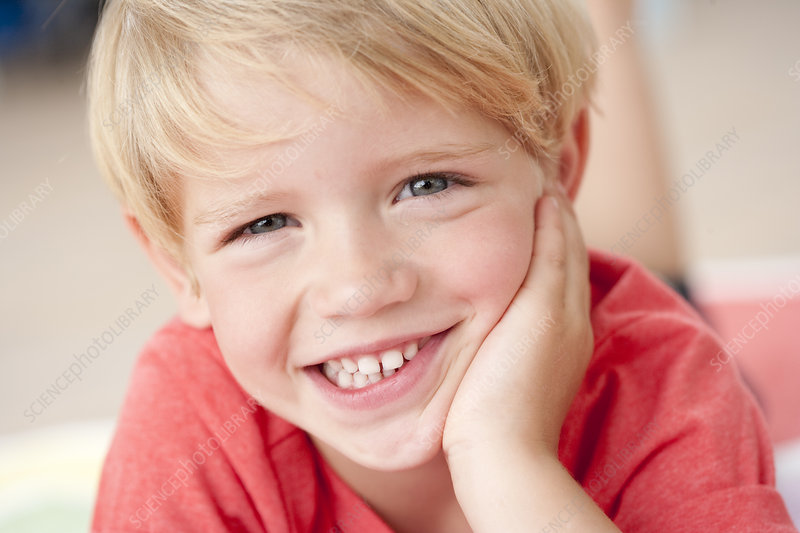 young boy smiling at viewer