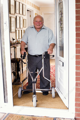 Senior Man at Home with Wheeled Walker
