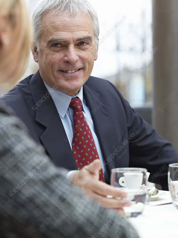 Close up of elderly man in a group meetin