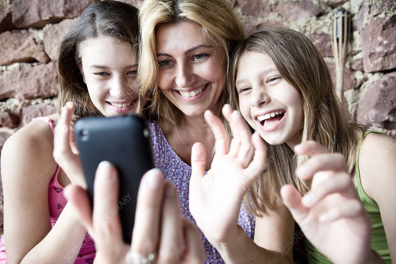 Mother and daughters video call on phone