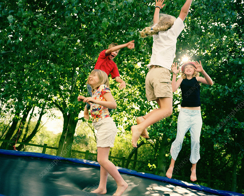 4 children leaping on trampoline