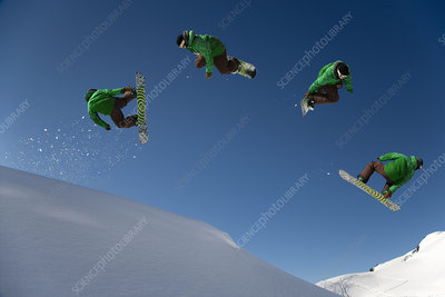 Snowboarder dangerous free ride jump