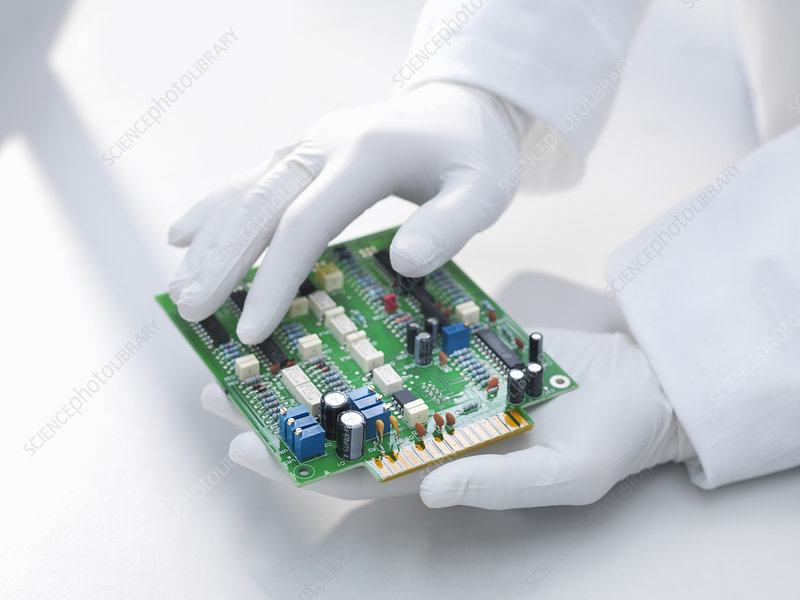 Hands holding circuit board