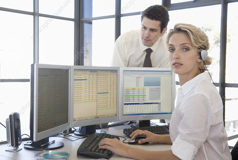 Buiness man and woman at the computer