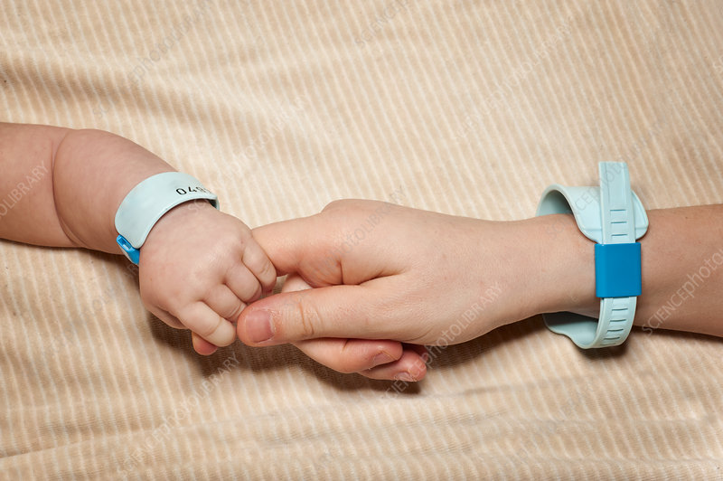 Newborn and mum with hospital bracelets
