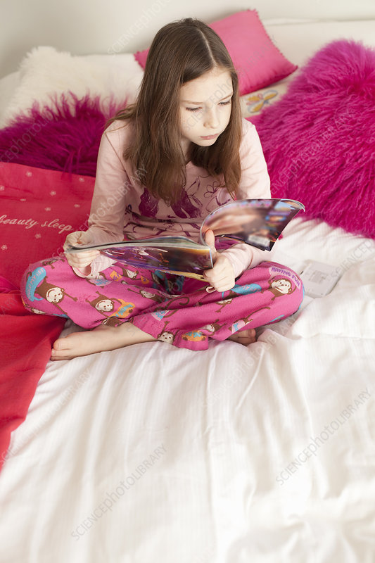 girl playing game on bed