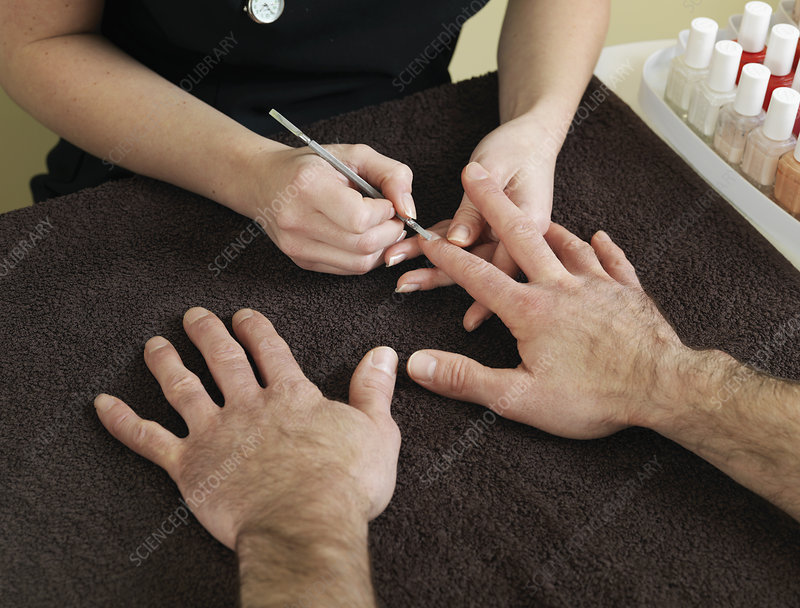 male hands receiving manicure