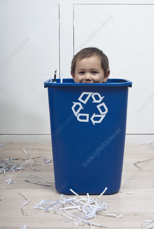 child in recycling bin