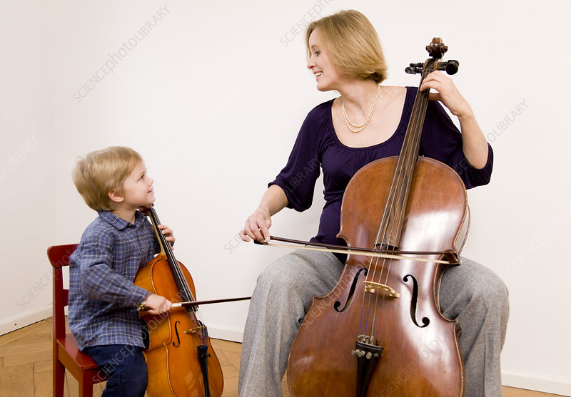 pregnant woman and boy playing Cello