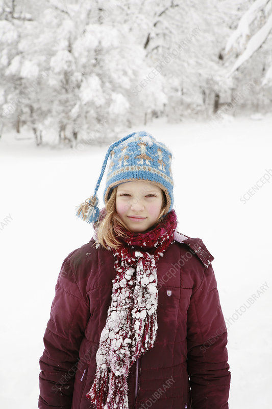 Girl covered in deep snow