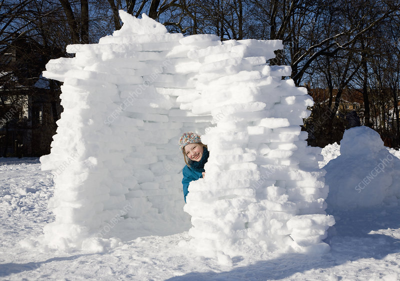 Girl in igloo in the snow
